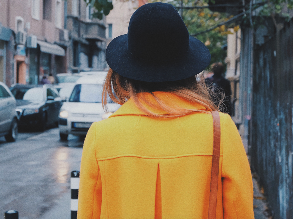 girl yellow coat