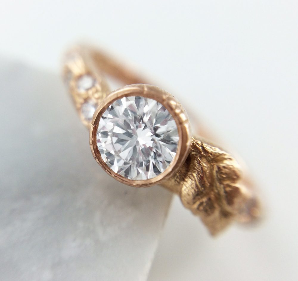 brushed rose gold bezel set round diamond engagement ring
