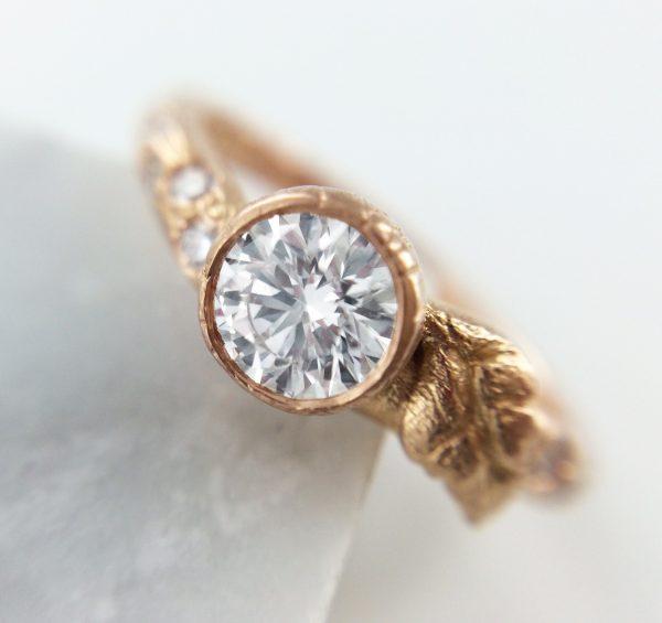 brushed rose gold bezel set round diamond engagement ring