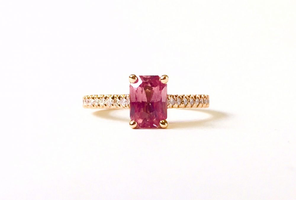 emerald cut pink sapphire with diamond pave rose gold band ring