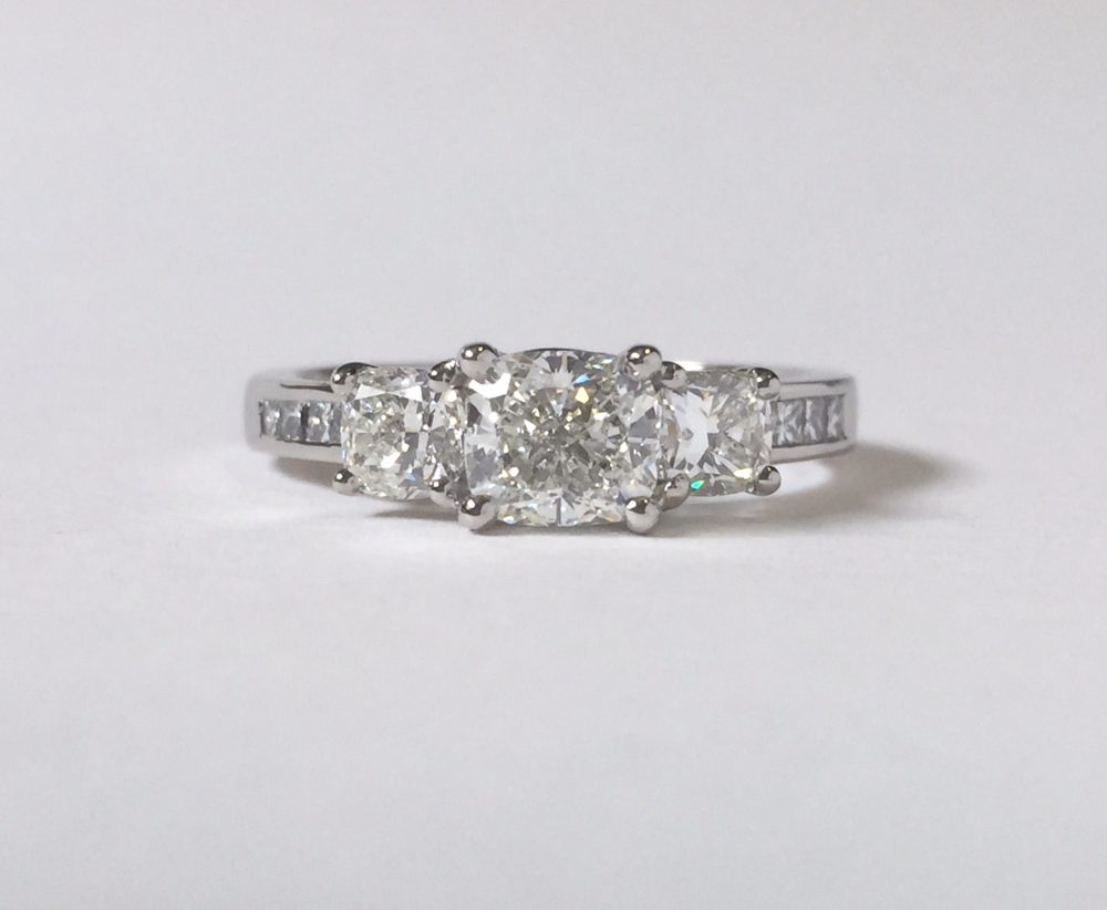 modern trilogy engagement ring