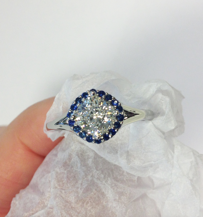 cushion cut diamond with blue sapphire halo