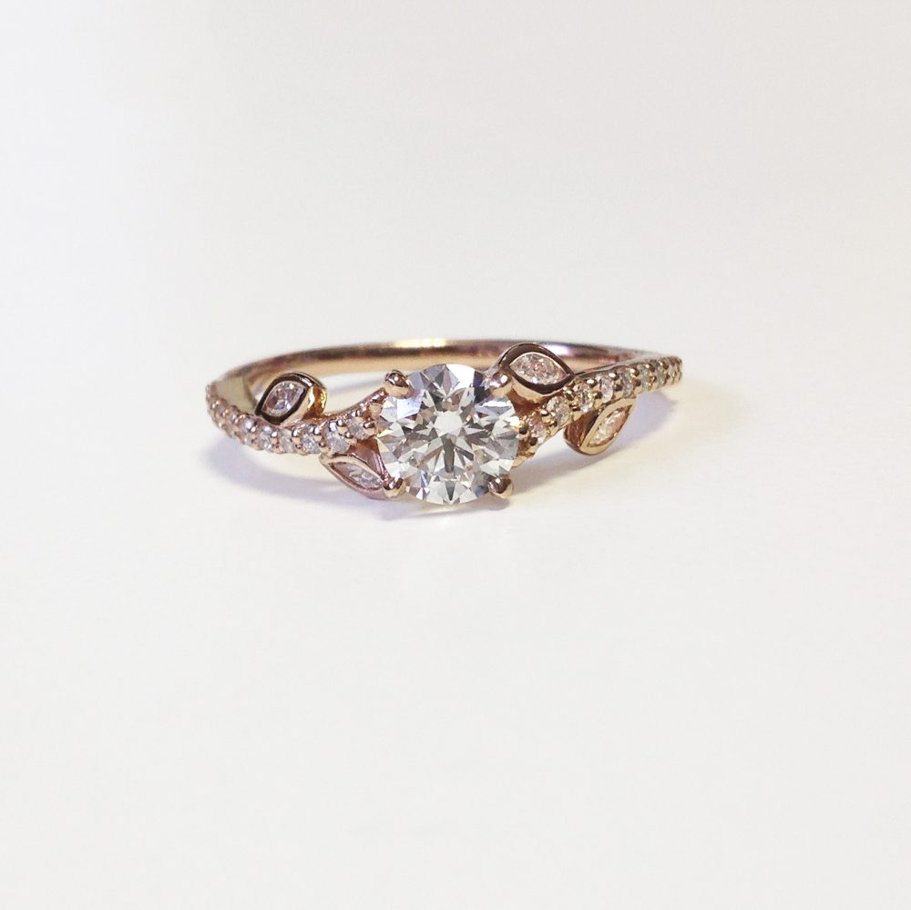 rose gold floral inspired ring with round diamond centre