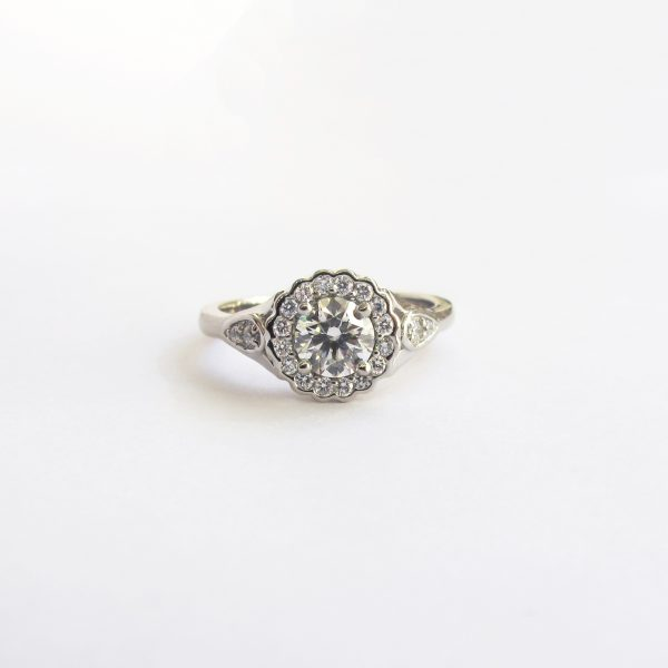 round diamond floral inspired halo engagement ring
