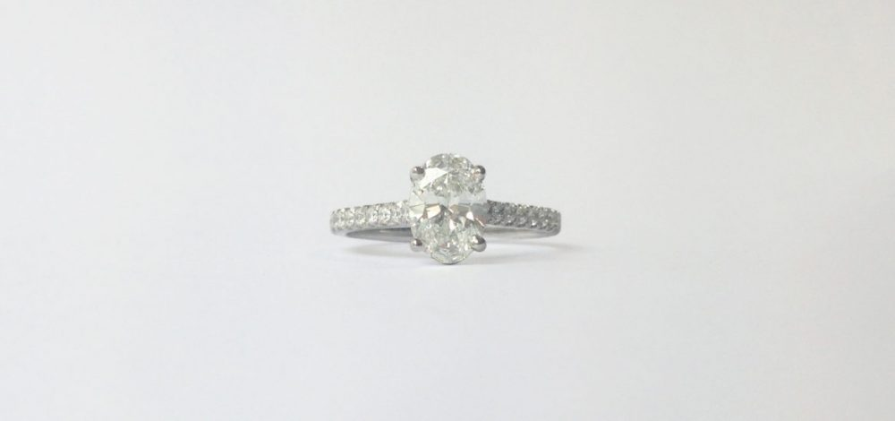 oval diamond pave engagement ring