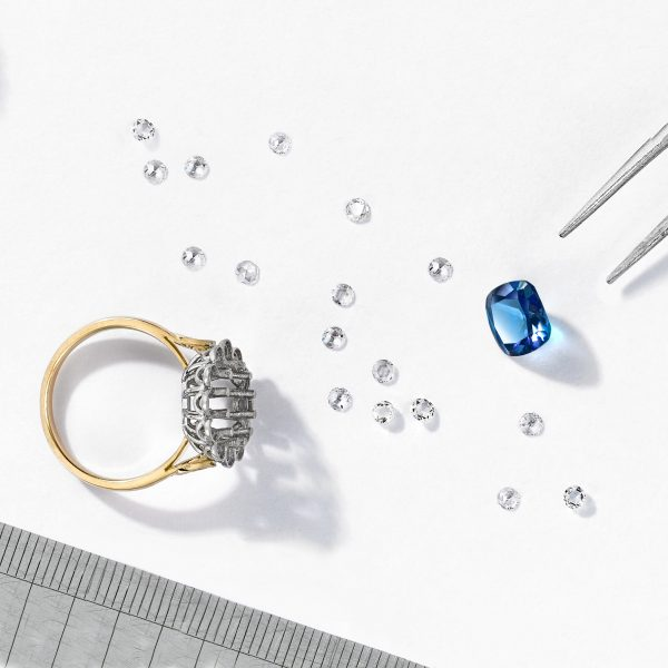 deconstructed-ring-with-blue-sapphire-and-rose-cut-diamond-halo