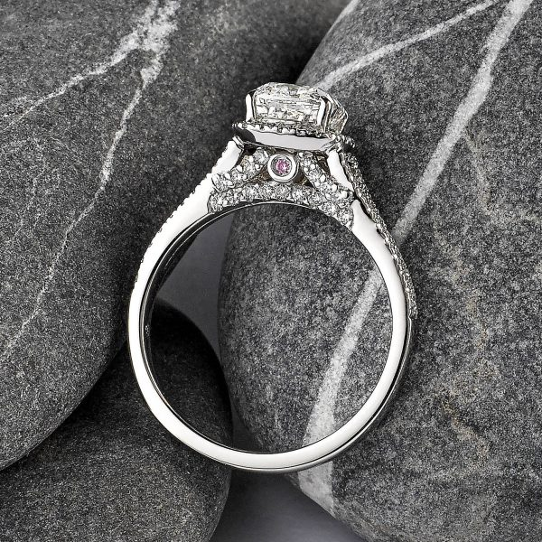 Cushion-cut diamond center with pavé diamond gallery & band set in platinum