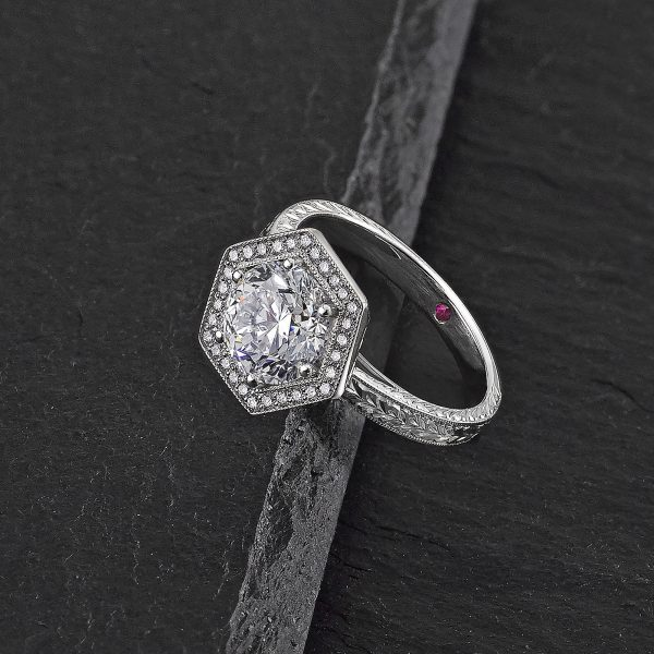 Round diamond with hexagonal diamond halo, milgrain detail - hand-engraved platinum band