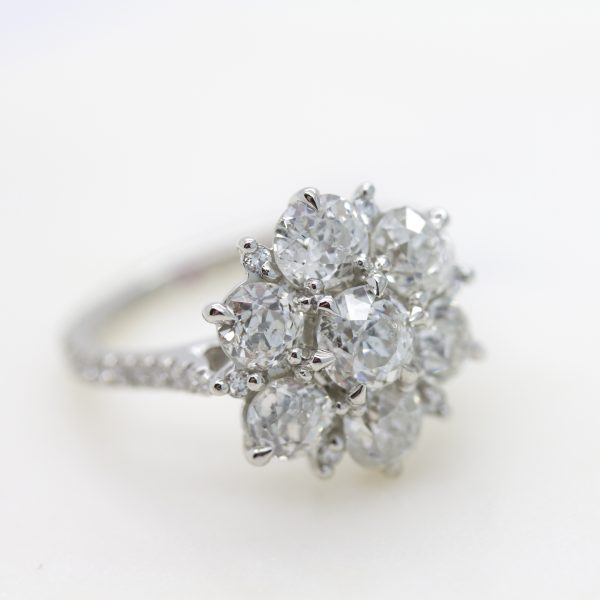Old European cut diamond cluster engagement ring