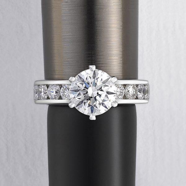 round centre diamond with channel set diamond in platinum engagement ring
