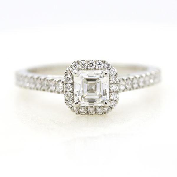 asscher cut diamond with diamond halo engagement ring