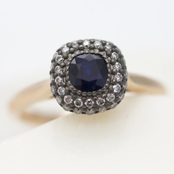 cushion cut blue sapphire with rhodium plated double diamond halo set in rose gold