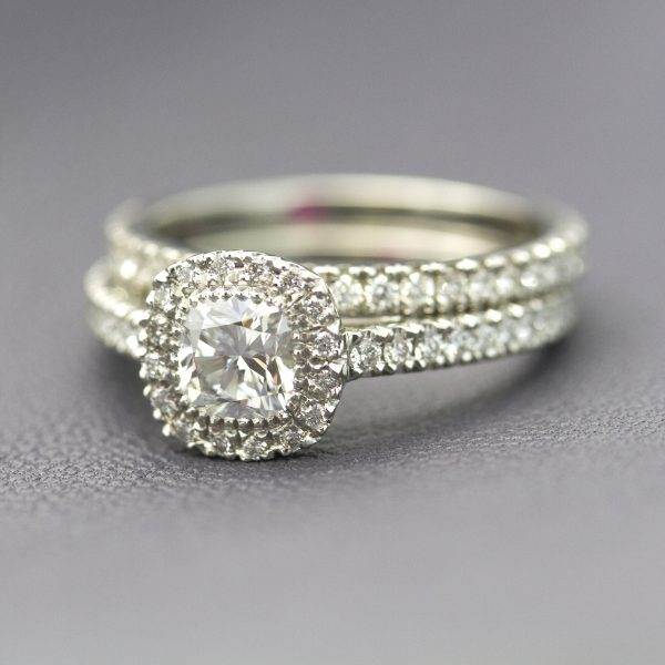 cushion cut diamond halo engagement ring with matching diamond pave wedding band