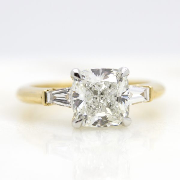 cushion cut diamond trilogy yellow gold engagement ring