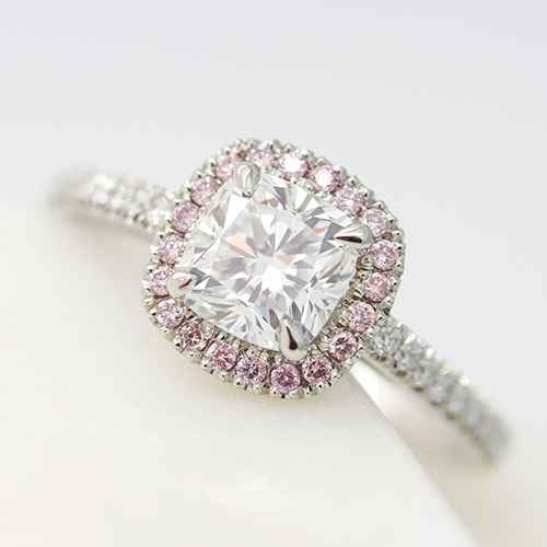 cushion cut diamond with pink diamond halo