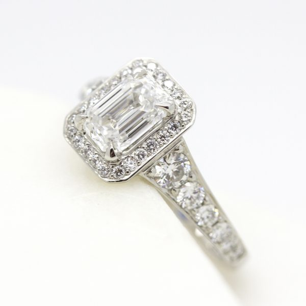 emerald cut diamond halo engagement ring with bead set diamond band