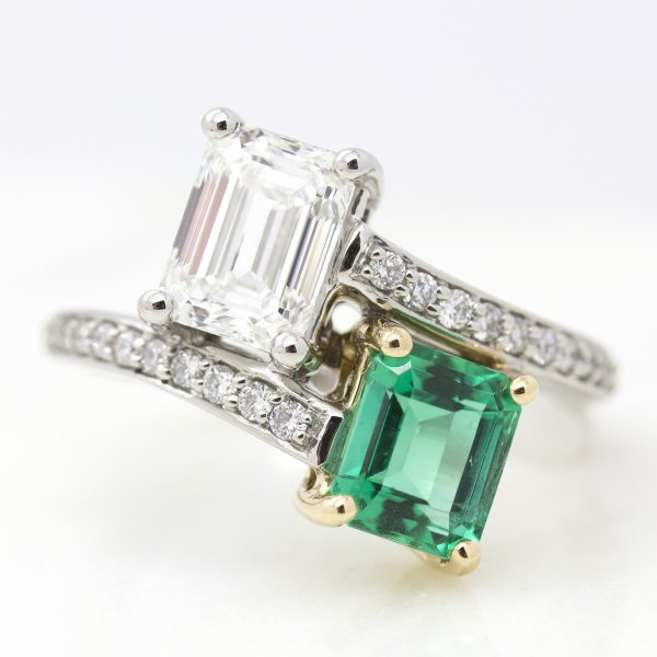 emerald cut emerald and diamond moi et toi engagement ring