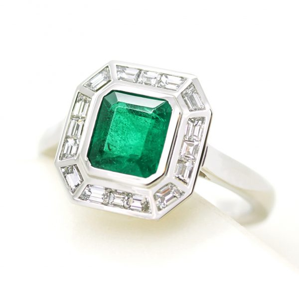 emerald cut emerald with custom cut diamond baguette halo engagement ring