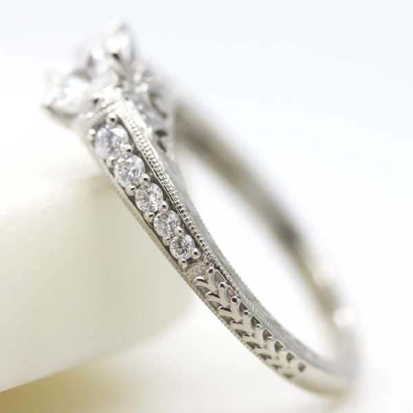 engagement ring with bead set diamond band, milgrain and hand engraving
