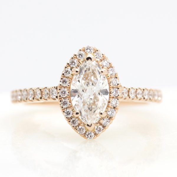 marquise cut diamond with diamond halo set in rose gold engagement ring