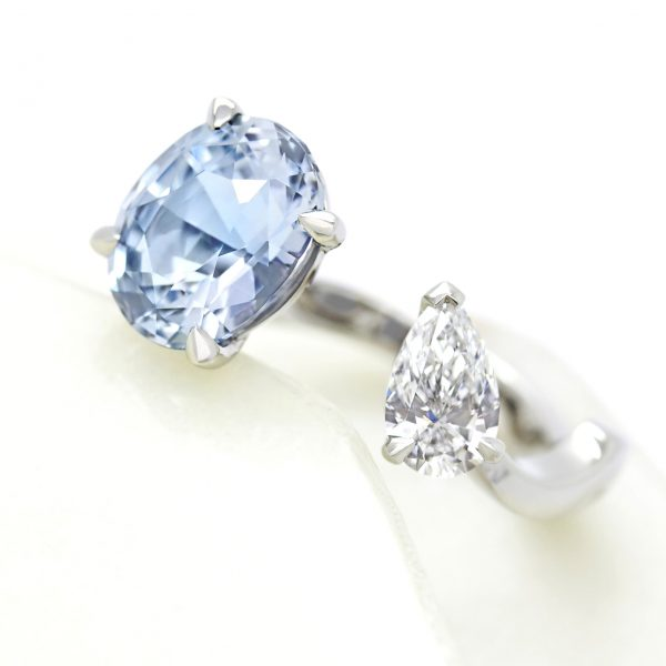 oval blue sapphire and pear white diamond ring