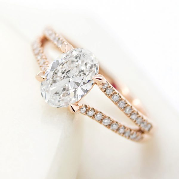 oval diamond engagement ring with split shank rose gold pave diamond band