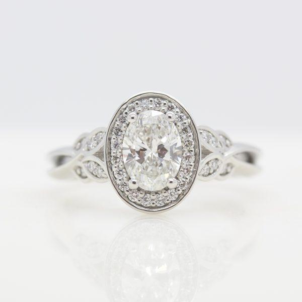 oval diamond with diamond halo and leaf inspired bead set accent diamonds