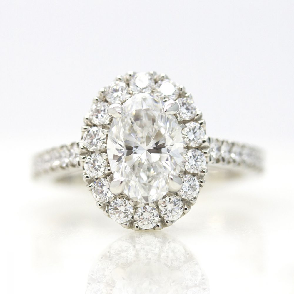 oval diamond with diamond halo and pave diamond band
