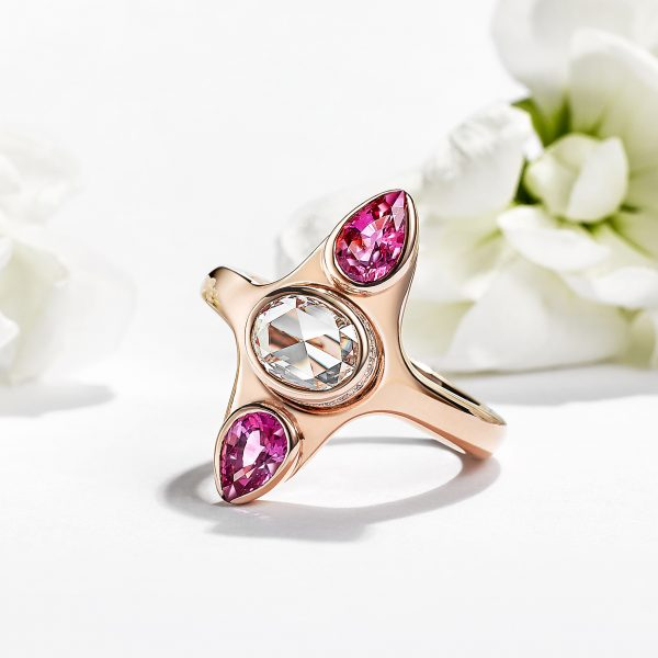 oval rose cut diamond with pear pink sapphires set in rose gold