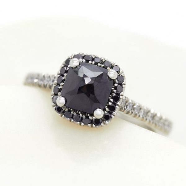 pavillion set blue sapphire engagement ring with black diamond halo