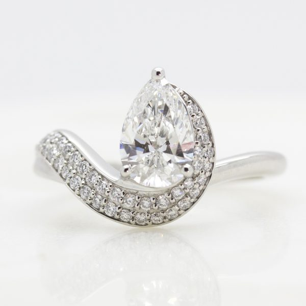 pear centre diamond with pave diamond wave engagement ring unique