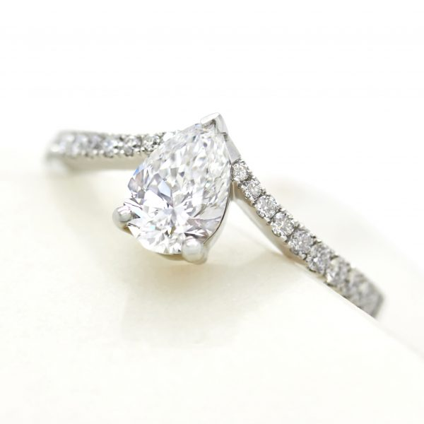 pear diamond engagement ring with chevron pave diamond band