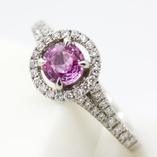 pink sapphire with separated diamond halo engagement ring