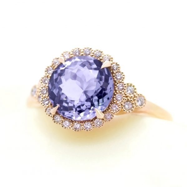portuguese cut purple sapphire with diamond halo, accent stones and milgrain