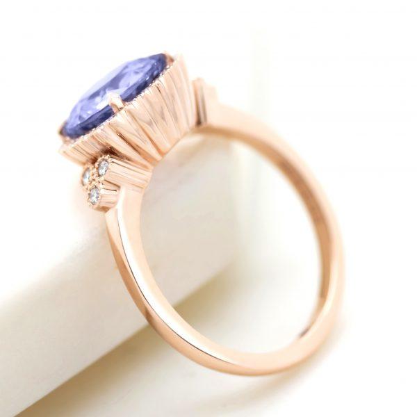 portuguese cut purple sapphire with diamond halo, accent stones and milgrain2