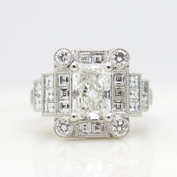radiant cut diamond with round and carre cut diamond halo engagement ring