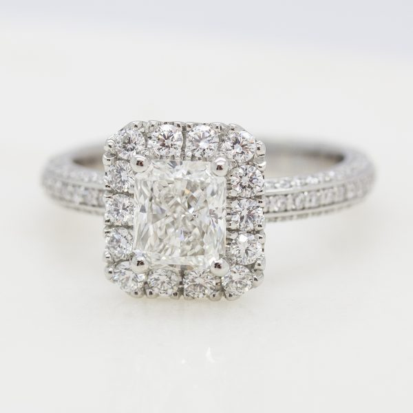 radiant diamond center with diamond halo and three sided diamond pave engagement ring