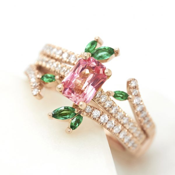 radiant padparadscha sapphire engagement ring with matching diamond pave organic inspired wedding band with marquise emeralds