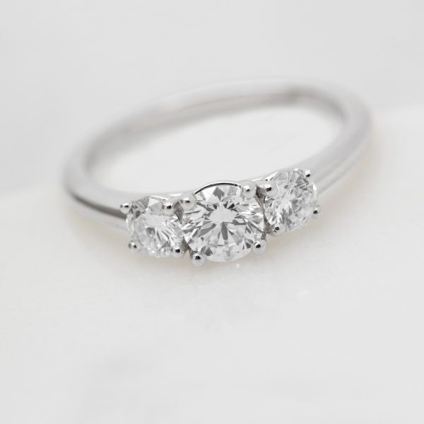 round trilogy engagement ring