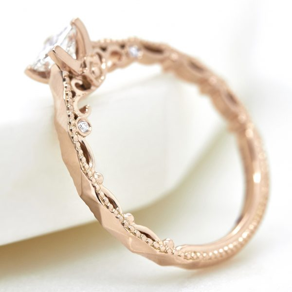 rose gold engagement ring with filigree and milgrain detail