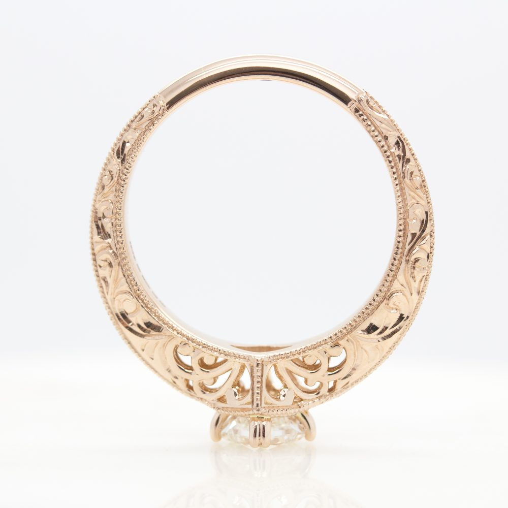 rose gold engagement ring with filigree cut outs and milgrain