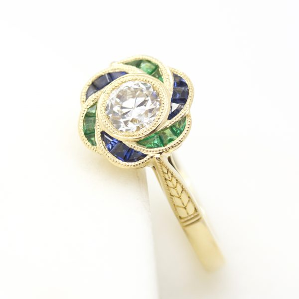 round bezel set diamond custom cut blue sapphires halo with milgrain hand engraved yellow gold