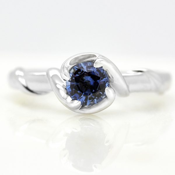 round blue sapphire with organic inspired branch band in platinum engagement ring