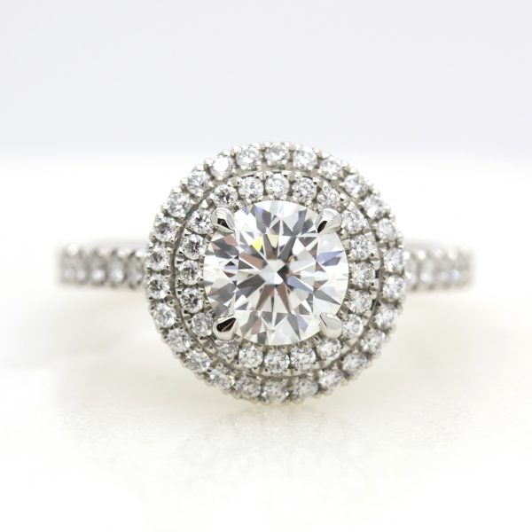 round centre diamond with double diamond halo engagement ring