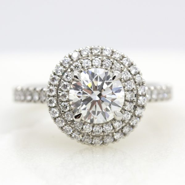 Round centre-diamond with double diamond halo engagement ring