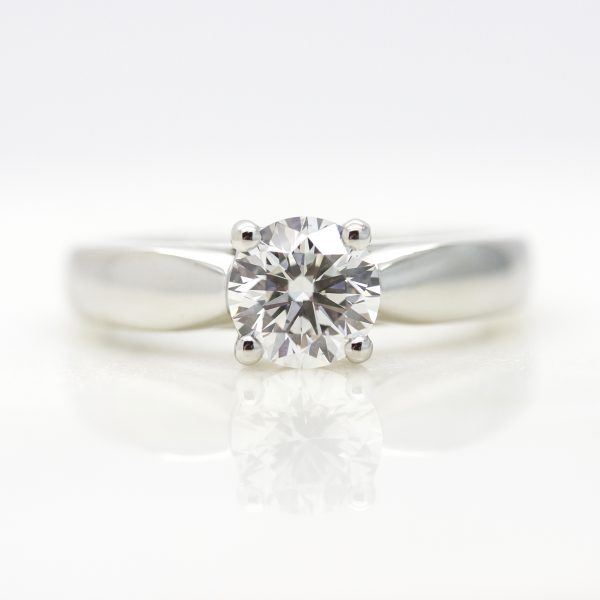 round diamond solitaire engagement ring with platinum tapered band