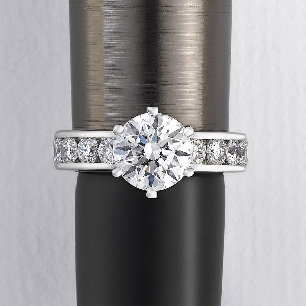 round diamond with channel set diamonds