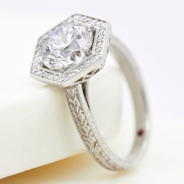 round diamond hexagonal halo engagement ring with wheat hand engraving