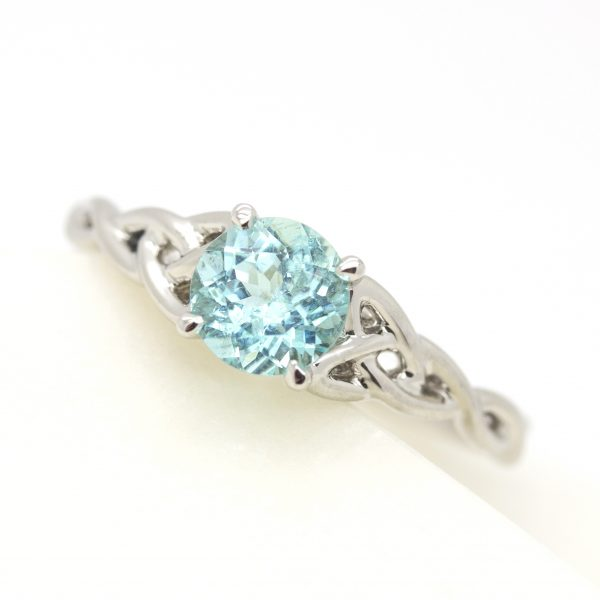 round paraiba tourmaline with gaelic celtic inspired band engagement ring