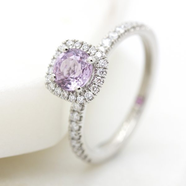 round pink sapphire with diamond halo engagement ring